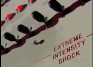 the infamous Milgram experiment shock box, with switches and in red letters EXTREME INTENSITY SHOCK